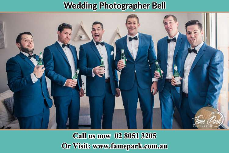 The groom and his groomsmen striking a wacky pose in front of the camera Bell NSW 2786