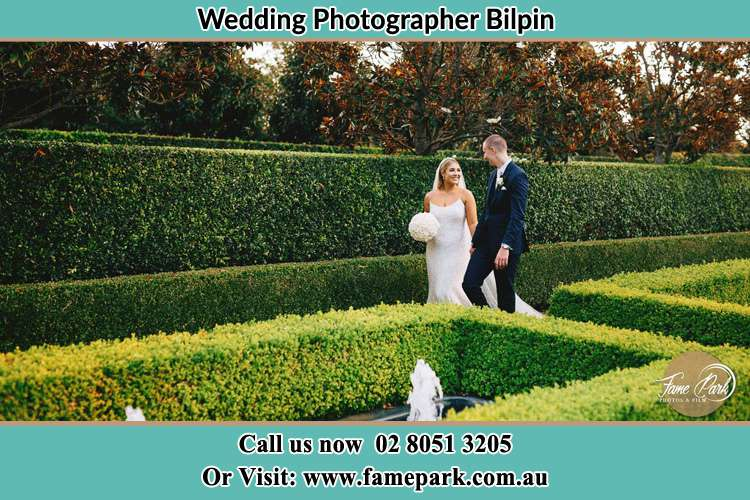 Photo of the Bride and Groom walking at the garden Bilpin NSW 2758