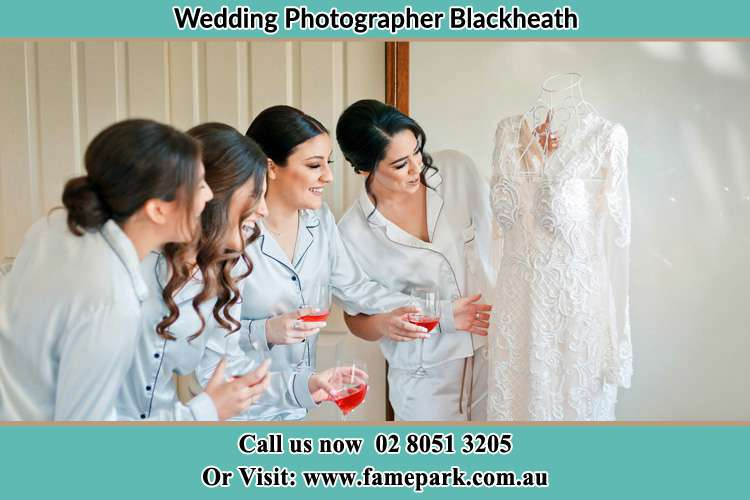 Photo of the Bride and the Bride's Maid looking at the gown Blackheath NSW 2785