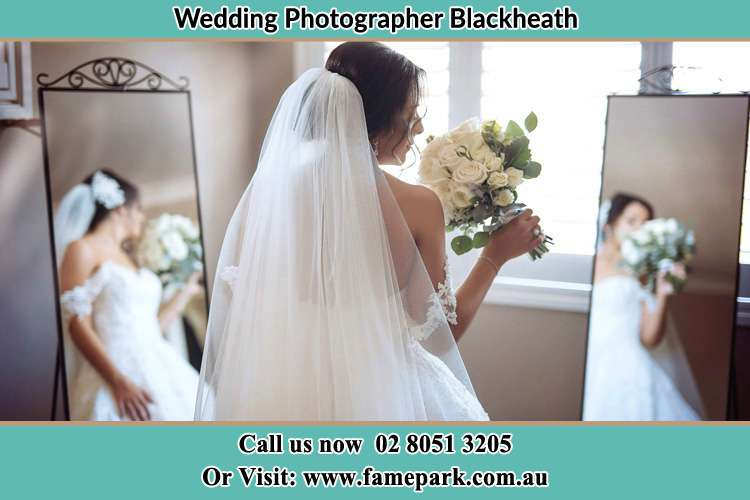 Photo of the Bride with flowers infront of the mirror Blackheath NSW 2785