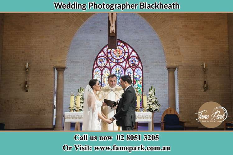 Photo of the Bride and Groom at the Altar with the Pastor Blackheath NSW 2785