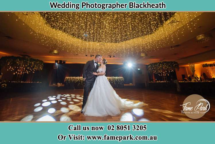 Photo of the Bride and Groom kissing at the dance floor Blackheath NSW 2785