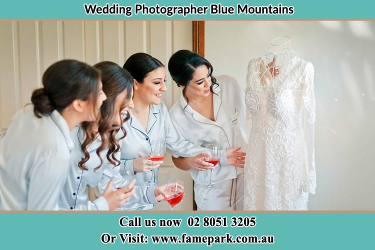 Brides party smiling at pretty brides dress Blue Mountains