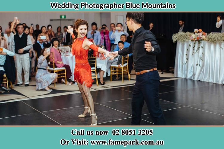 Bride in red dress dancing with groom Blue Mountains