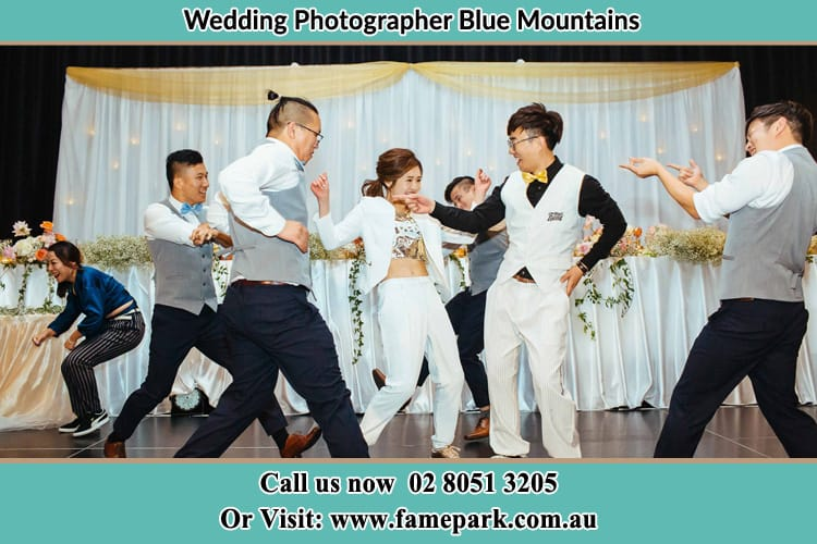 Wedding party having fun dancing Blue Mountains