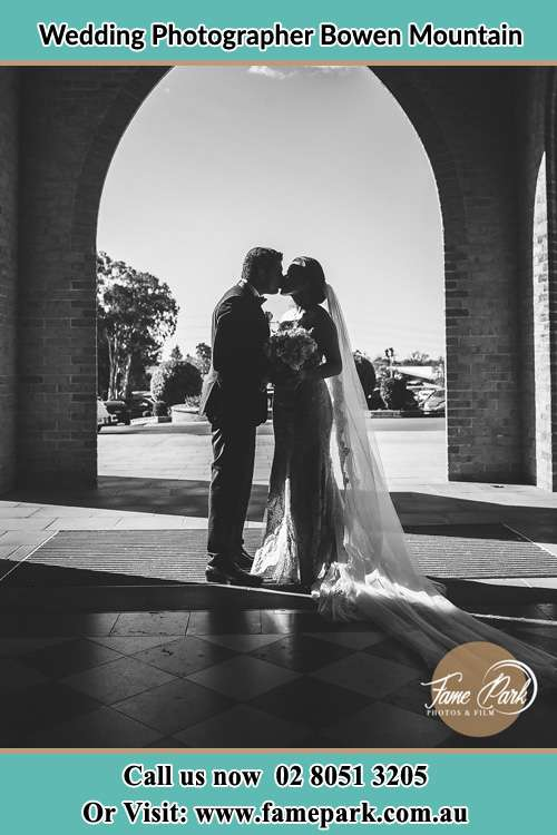 Photo of the newly weds kissing Bowen Mountain NSW 2753