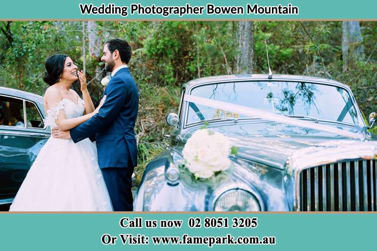Photo of the Bride and Groom beside the bridal car Bowen Mountain NSW 2753