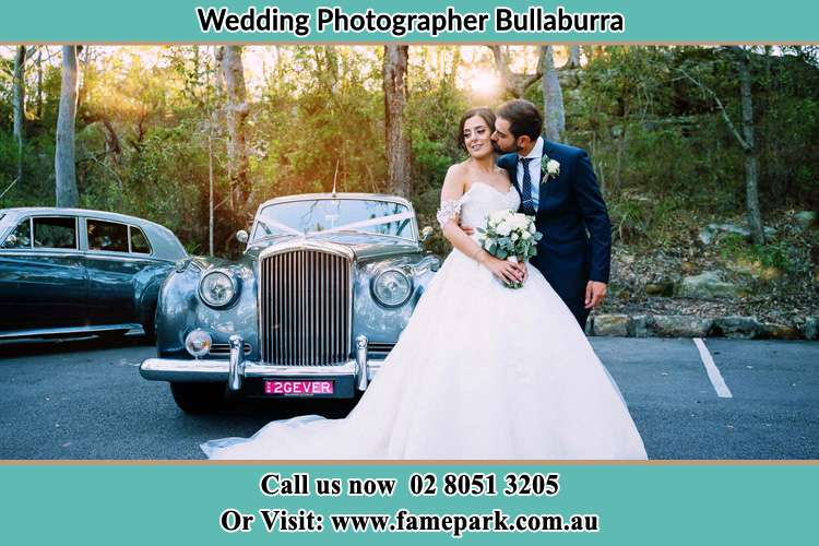 Photo of the Bride and Groom besides the bridal car Bullaburra NSW 2784