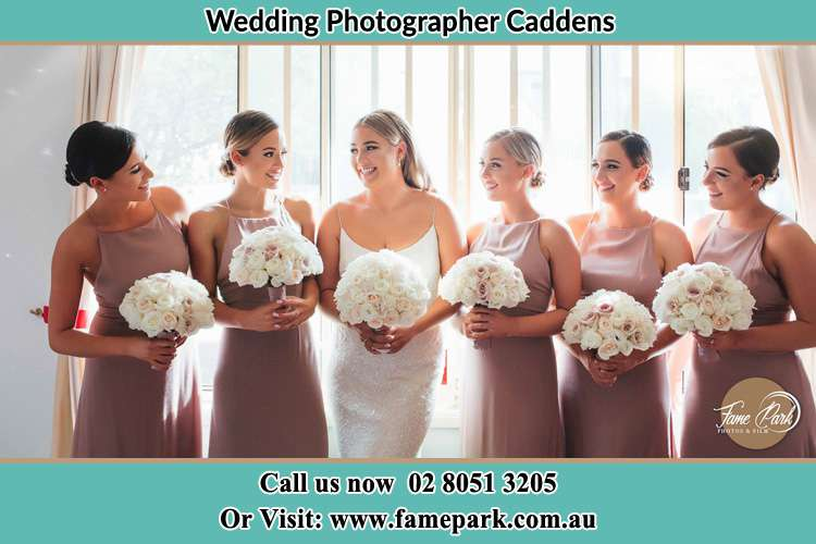 Photo of the Bride and her bridesmaids each holding a bouquet of flowers Caddens NWS 2747