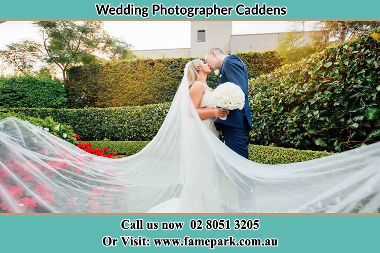 Photo of the newly weds kissing in the garden Caddens NWS 2747