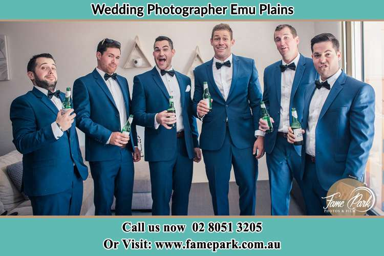 The groom and his groomsmen striking a wacky pose in front of the camera Freemans Reach NSW 2756