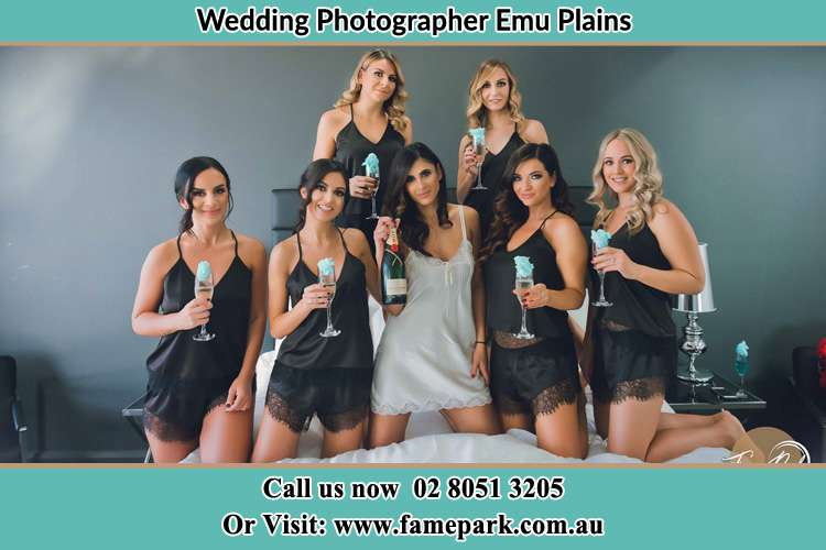 Bride and her bride's maid holding wine in bed Emu Plains NSW 2750