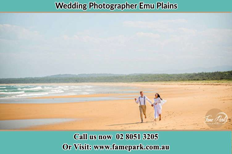 Bride and Groom running in the beach Emu Plains NSW 2750