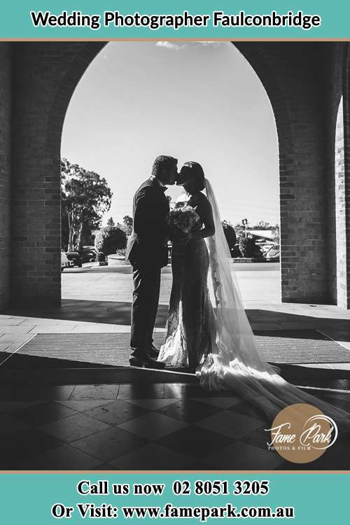 Bride and Groom kissed in front of the church Faulconbridge NSW 2776