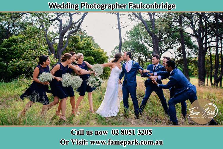 Bride and Groom with their secondary sponsors up the hill Faulconbridge NWS 2776