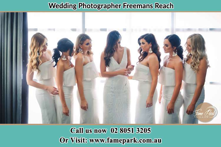 Bride and her bride's maids in all white dress Freemans Reach NSW 2756
