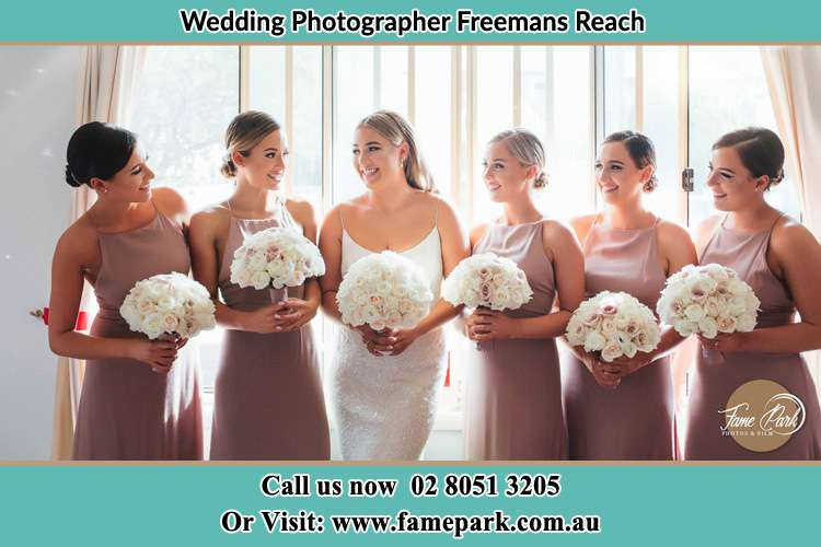 Bride and her bride's maids holding bouquets of flowers Freemans Reach NSW 2756