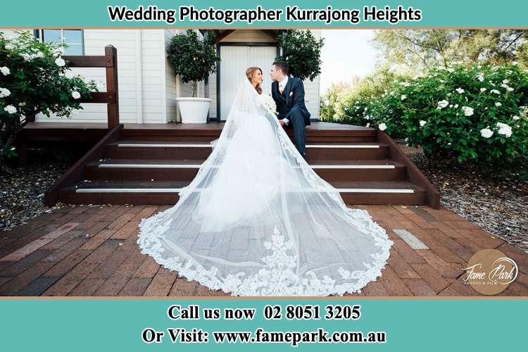 Photo of the Bride and Groom sitting in the stairs Kurrajong Heights NSW 2758