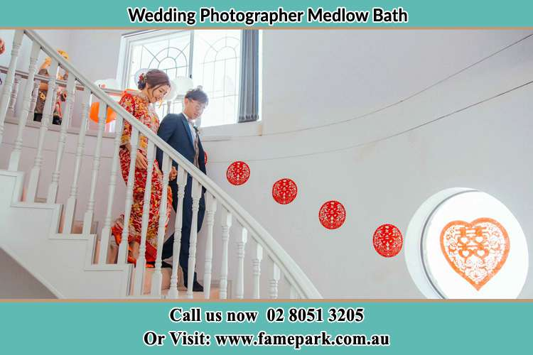 Photo of the Bride and the Groom walking down the stairs Medlow Bath NSW 2780