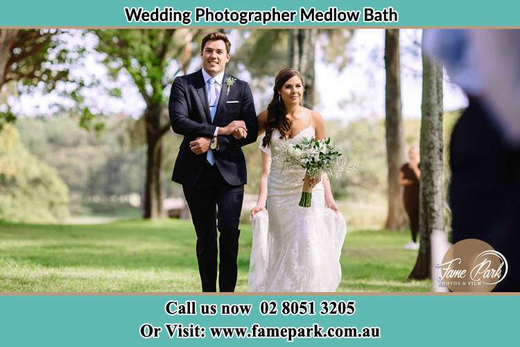 Photo of the Bride and the Groom marching the aisle Medlow Bath NSW 2780
