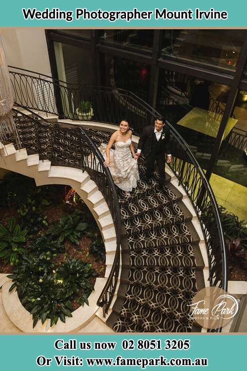 Photo of the Bride and Groom going down the stairs Mount Irvine