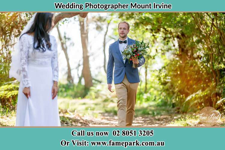Photo of Groom bringing flower to the Bride Mount Irvine