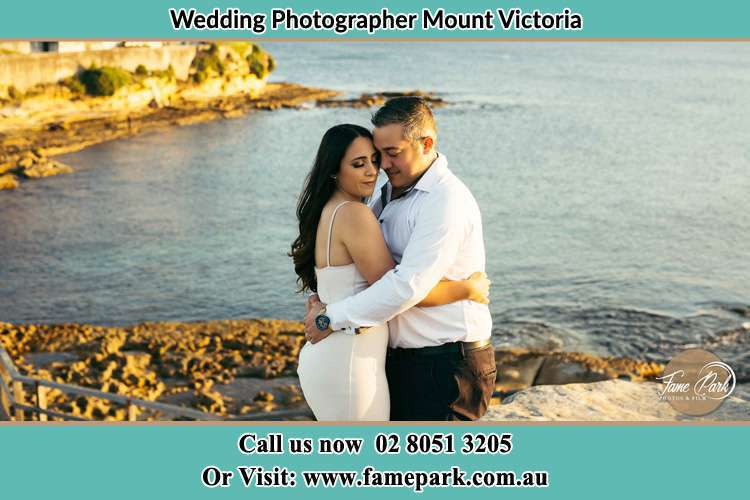 Photo of the Bride and Groom hugging Mount Victoria