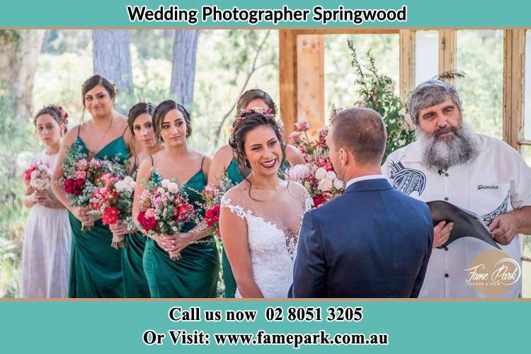 Photo of the Bride and the Groom during the ceremony Springwood