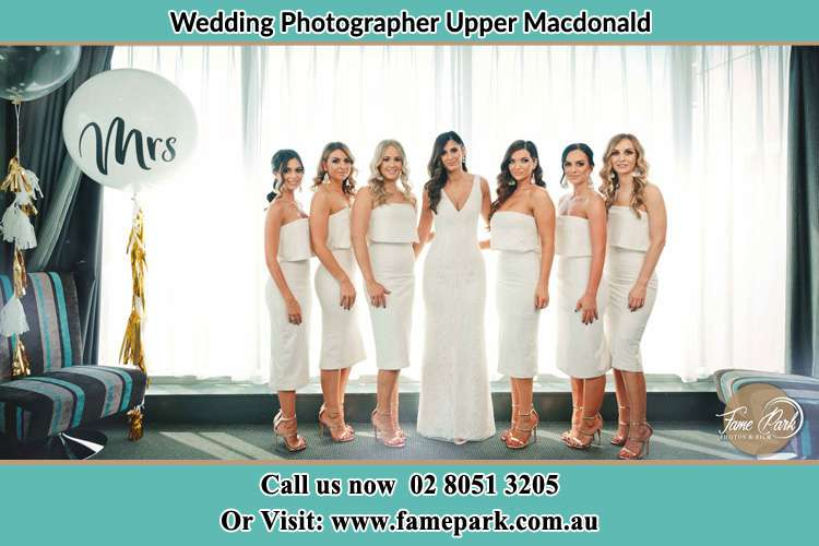 The Bride and her bridesmaids posed for the camera Upper Macdonald