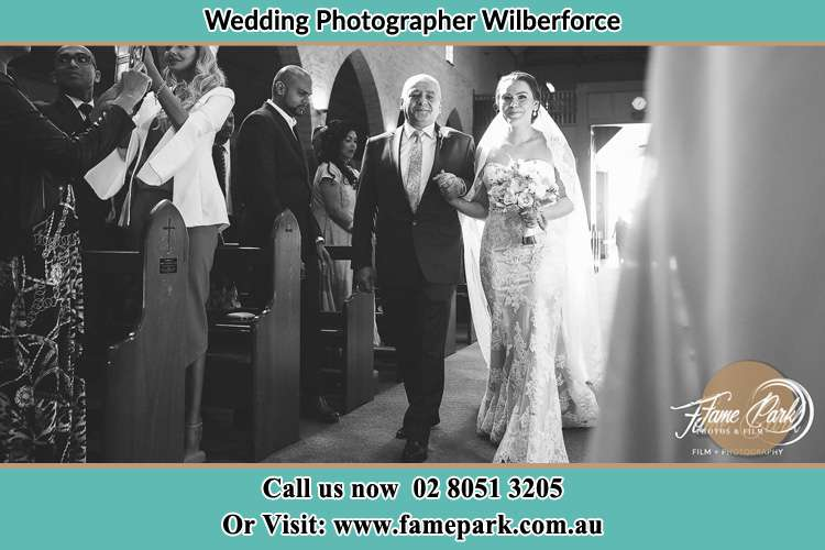 Photo of the Bride with her father walking down the aisle Wilberforce