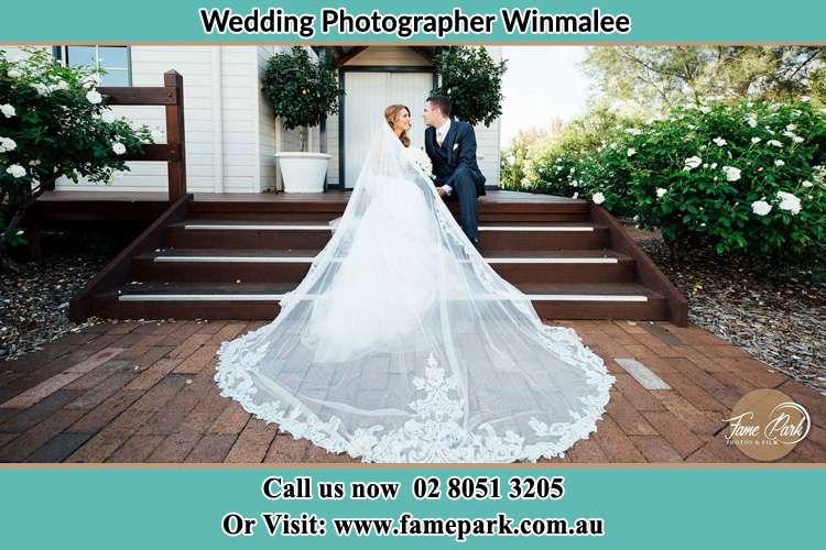 Photo of the Bride and Groom siitting in the stairs Winmalee