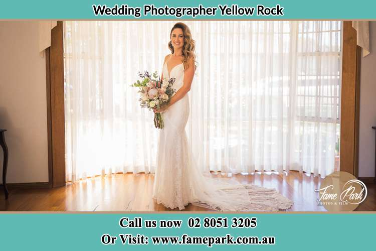 Photo of the Bride holding flowers Yellow Rock