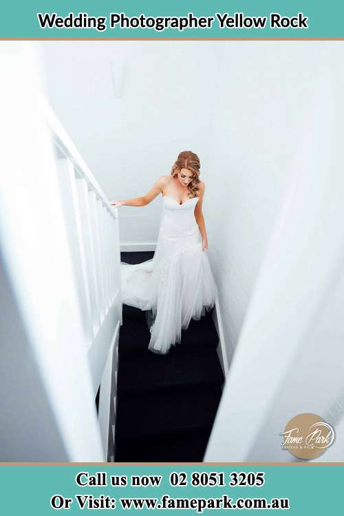 Photo of the Bride walking down the stairs Yellow Rock